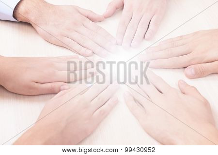 Many hands with light