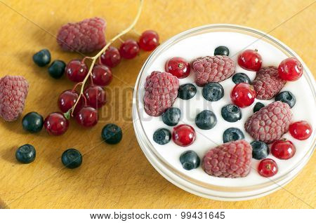 Delicious Dessert Made Of Yoghurt And Ripe Berries