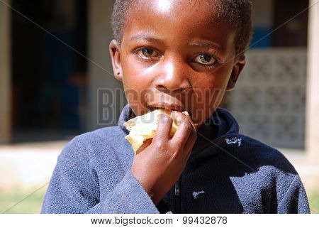 An African Child While Eating A Typical Pancake Cornmeal - 076