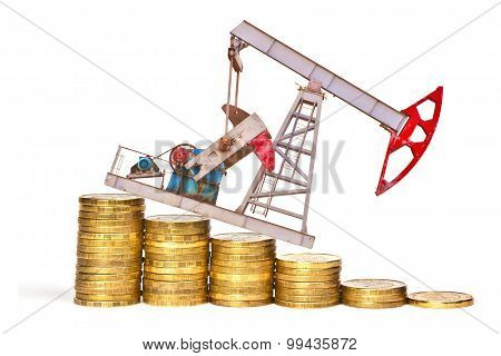 Oil Pump And Stack Of Coins Isolated On White Background. The Concept Of Oil Crisis