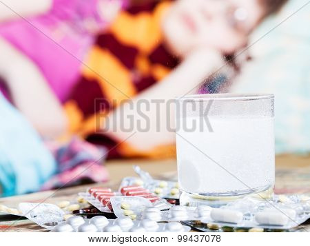 Drug Dissolves In Water And Pill On Table Close Up