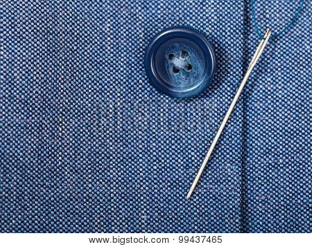 Attaching Of Button To Blue Silk Tissue By Needle