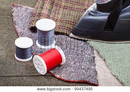 Iron And Thread Spools On Fabrics