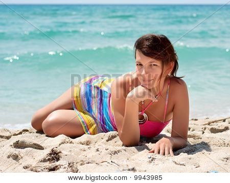 Woman In A Colorful Dresst On The Beach