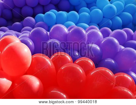 Red, violet and blue balloons