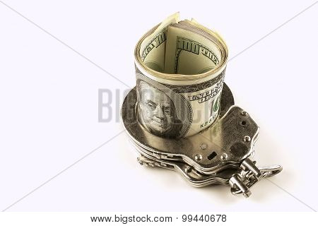 Dollars And Steel  Handcuffs On A White Background