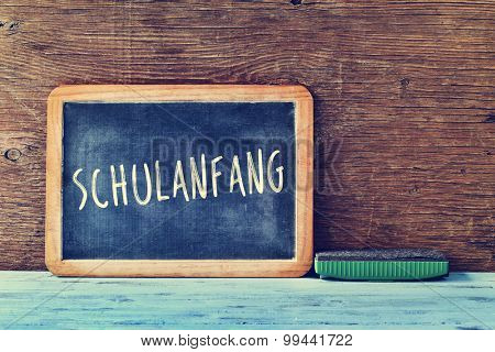 a chalkboard with the text schulanfang, back to school in german written in it, and an eraser on a rustic wooden table, cross processed