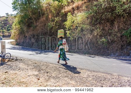 Ethiopian Woman Walking On The Road.
