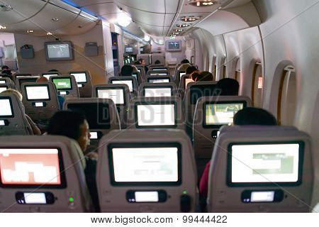 DUBAI, UAE - APRIL 18, 2014: Emirates Airbus A380 interior at night. Emirates handles major part of passenger traffic and aircraft movements at the airport.