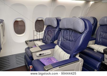HONG KONG - APRIL 22, 2014: Malaysian Boeing 737 interior. Malaysian Airline System is a major airline operating flights from Kuala Lumpur International Airport