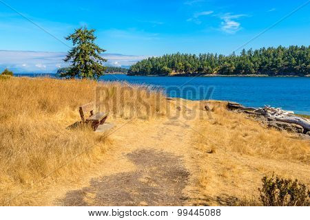 A picnic bench with gorgeous view at mountain lake, British Columbia, Canada.
