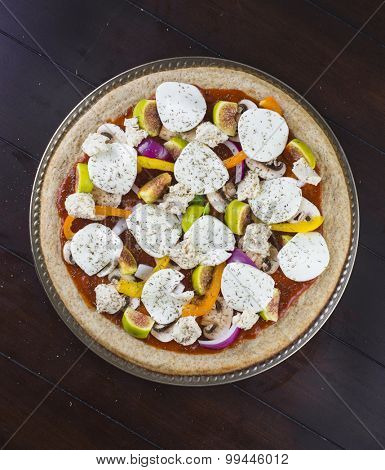 Delicious veggie pizza with fresh toppings and goat cheese