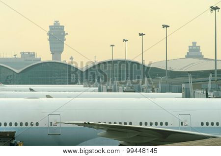 HONG KONG - MARCH 09, 2015: Cathay Pacific aircraft near boarding bridge. Cathay Pacific is the flag carrier of Hong Kong, with its head office and main hub located at Hong Kong International Airport.