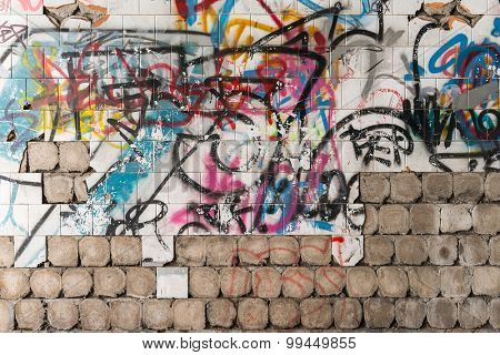 Graffiti painted on the dirty old wall
