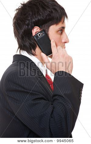 Serious Businessman With Cellphone