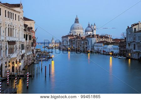 View of the Grand Canal with Basilica di Santa Maria della Salute in the background during sunset as