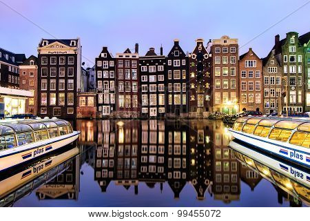 Canal side houses and tour boats, Amsterdam, Netherlands