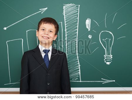 school boy in suit show success graphs on board
