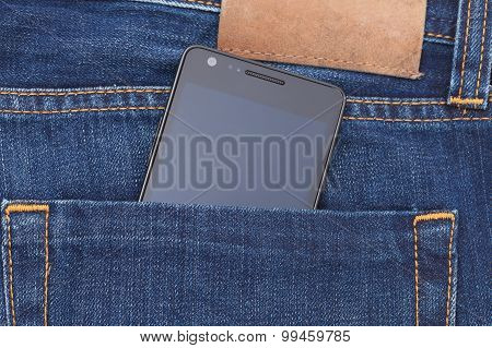 Modern phone in jeans pocket displaying screen.