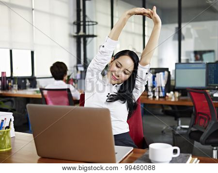 Asian Business Woman Stretching Arms