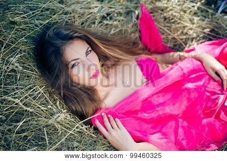 Sexi pensive young lady with long hair in pink