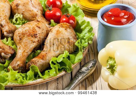 Baked Chicken Legs With Vegetables On Plate