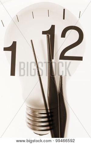 Clock Hands And Light Bulb