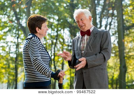 Senior Man Talking With Woman