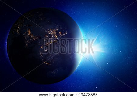 Earth view from space with sunrise. Elements of this image furnished by NASA.