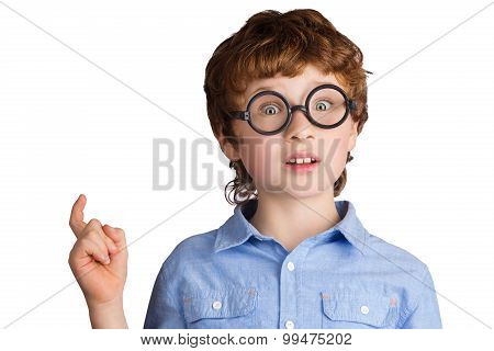 Portrait of handsome boy in round glasses who just has got an idea. Isolated on white background