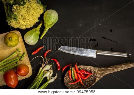 Young Spring Vegetables On Black Chalkboard From Above. Background Layout With Free Text Space. Carr