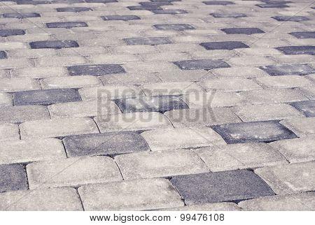 Gray brick stone street road. Light sidewalk, pavement texture