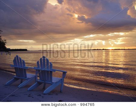 Adirondack Chairs At Blue Sunset