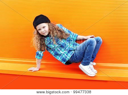 Dance And Fashion Kid Concept - Stylish Little Girl Child Wearing A Shirt And Cap Dancing In The Cit