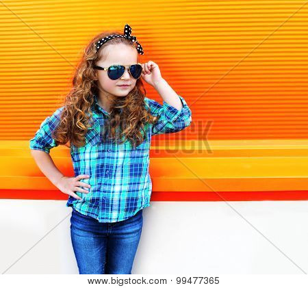 Fashion Kid Concept - Portrait Of Stylish Little Girl Child Wearing A Shirt And Sunglasses Posing Ag
