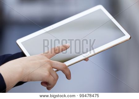 Businesswoman holding digital tablet, closeup