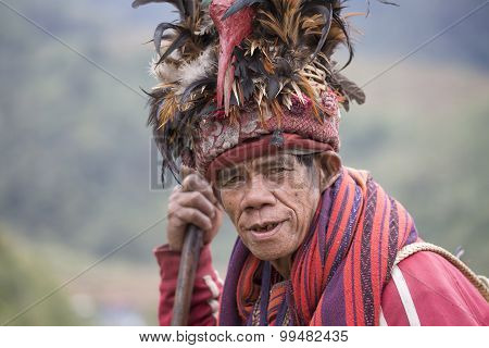 Portrait Ifugao Man In National Dress Next To Rice Terraces.. Philippines.