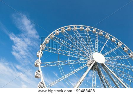 white ferris wheel against blue sky background