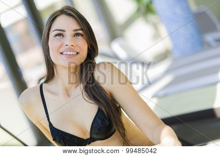 Beautiful woman relaxing in swimsuit and sunbathing
