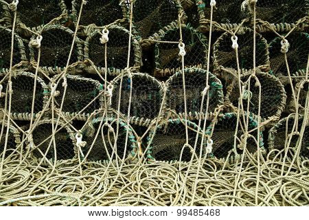Lobster trap with the rope on a pier