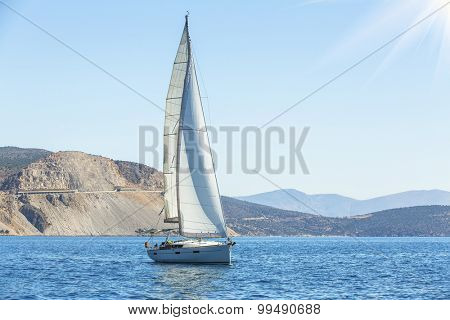 Sailing. Yacht sails with beautiful sky. Luxury yacht.
