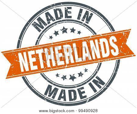 Netherlands Orange Grunge Ribbon Stamp On White