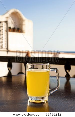 Glass Of Beer With Lemon Near The Sea.