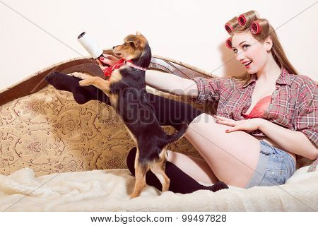Sexi young smiling girl playing with a dog