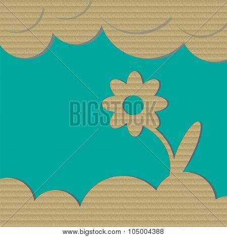 Cardboard flower on green background