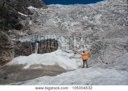 Tourist Looks At Icefall