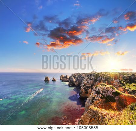 Rocky beach at sunset, Lagos, Portugal. Counter light