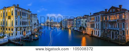 Gorgeous view of the Grand Canal and Basilica Santa Maria della Salute after sunset , Venice, Italy