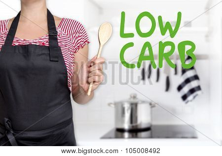 Low Carb Cook Holding Wooden Spoon Background Concept