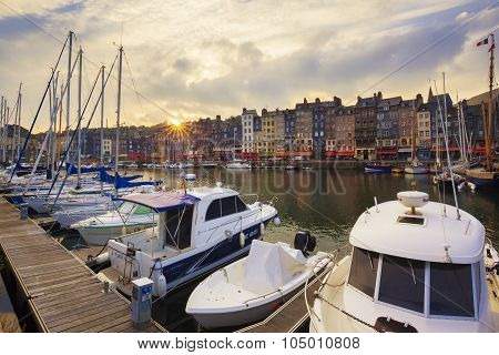 HONFLEUR FRANCE - OCTOBER 12: The old port of Honfleur at sunset famous for having been painted many times by artists on October 12 2015 in Honfleur France